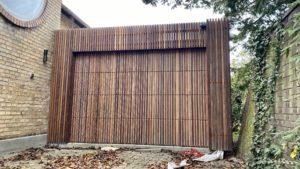 Træ ledhejseport med lister